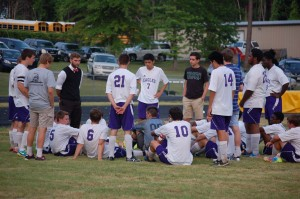 Devin Pierce speaks to his team during half-time of a home match. (Photo by Hannah Davis)