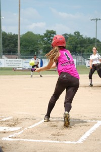 PEFYA's Lexi Marzloff bunts the ball in a game against Amherst. (Photo by Hannah Davis)