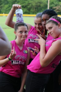 A few of the PEFYA Belles players have fun posing for a picture during the District 1 All-Star Tournament. Pictured are PEFYA players, from left, Maddie Moreland, Gracie Hodges, SaRoya Walton and Hannah-Gray Schmidt. (Photo by Farrah Schmidt)