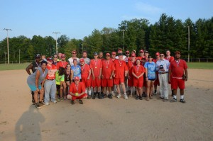 Participants who played in the Guns 'N Hoses Softball Tournament gather together for a celebratory picture at the end of the exhibition game. (Submitted photo)