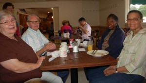 Former colleagues, from left, Shirley Moore, James Moore, of Farmville, and Annie Irene Gilliam and Lou Bertha Carter, of Cumberland, met at the annual reunion for Craddock-Terry employees.