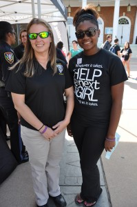 Farmville Police Officer Christie Mouser, left, and Alpha Beta Psi's Vice President and Chaplain Keya Jackson, took a stand against violent acts committed towards women in the community during the Save The Next Girl community partnership kick-off held in September. Italia Gregory - Herald