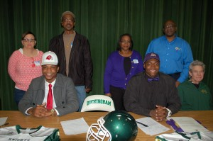 Buckingham's Leon Ragland singed with Fairmont State University, while Michael Mabry signed with JMU. Pictured are, from left, seated, Ragland, Mabry, BCHS varsity football coach Craig Gill; standing, Rose Gough (guardian), Bradley Gough (guardian), Dianne Mabry (mother) and Michael Mabry (father).