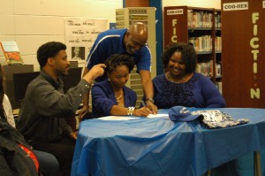 Cumberland's Ebony Jones signs her letter of intent to St. Andrews University. Pictured are, from left, Darren O. Jones (father), Ebony Jones, St. Andrews track & field coach Charles Stallworth and Tiffany Jones (mother).