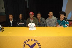 Prince Edward's Delquan Bigelow signed with Bridgewater College on Wednesday. He was supported by his brothers, mother and father during the event. Pictured are, from left, Marquis Brown, Tyvon Brown, Bigelow, Tina Bigelow, John Robertson and Quantavis Nash.