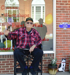 Que Wilhelmi greeted visitors on opening day of Red Door 104 last May. The scholarship, recently established in his memory, will offer art education to local youngsters.