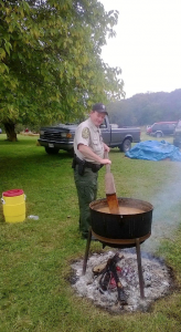 James River State Park manager Russell Johnson stirs a pot of stew during the park's annual Fall Festival.