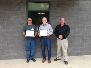 Pictured are car drivers, from left, Lee Halbohn, Andy Evans and Palmore.