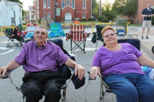 """IRELAND SEAGLE I HERALD Julian and Edwina Covington wait patiently for """"Meet Me in St. Louis"""" to begin. They have attended every movie in the series for the past few years."""