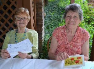 Nan Colvin, left, received the Benchmark Bank Award, and Judy Jamieson received the Ruth Adams Award.
