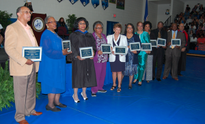 ITALIA GREGORY | HERALD Pictured are, from left, members and representatives of the Cumberland 10. Pictured are, Joe Washington, accepting for his sister, Gloria Washington, Ernestine Jones Monroe, LaVerne Reid Depte, Shirley White, Gwendolyn Lipscomb, the Rev. Kern Gilliam, Rosalind Gilliam, Yetta Anita Gilliam, the Rev. Robert R. Jones and George Reid, accepting for his brother, Samuel O. Reid. The honorees received framed copies of the plaques at gradation on May 20.