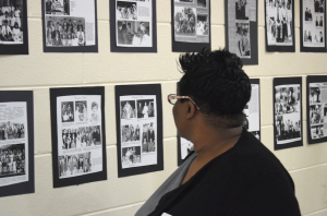 MARGE SWAYNE   HERALD A wall of fame — Pam Gray looks over a wall full of memories from Nancy Anderson Haga's years of coaching Forensics and Debate at Prince Edward Academy/Fuqua School.