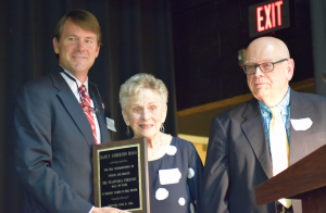 MARGE SWAYNE   HERALD Fuqua Head of School John Melton, left, and Dr. Robert Frank, right, recognize Nancy Anderson Haga as the first member of the Forensic Hall of Fame named in her honor.