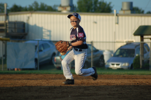 PEFYA Instructional Machine Pitch All-Star Johnny Luhn prepares to make a throw on defense during the Dixie Youth District V Instructional All-Star Tournament on Friday at PEFYA's Field of Dreams complex. (Photo by Titus Mohler)