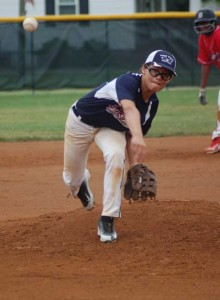 PEFYA All-Star Nate Reed, pictured pitching against the Dinwiddie National All-Stars on Sunday, hit a grand slam on Tuesday against the same team in the Dixie Youth District 5 Major League All-Star Tournament championship game in Blackstone. (Photo by Titus Mohler)