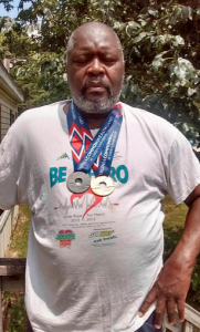 TONI RUSSELL Prince Edward County High School Head Track and Field Coach James Baker wears his medals earned at the 2016 Commonwealth Games in Lynchburg.