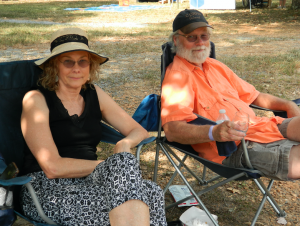 TITUS MOHLER | HERALD Ginger Downes, left, and Willie Downes, of Farmville, relax in the shade, enjoying the music of Sean Fír.