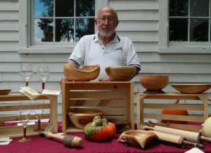 TITUS MOHLER | HERALD Pete Johnson, from outside of Mount Jackson, stands behind a display of his creations that he was selling at the festival.