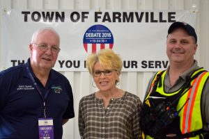 On debate day, Farmville Town Manager Gerald Spates and his wife Linda were at the Fireman's Sports Arena to assist K. C. Sehlhorst, right, with the Central Virginia All Hazards Incident Management Team. Sehlhorst was in charge of logistics for the debate team of law enforcement and public safety personnel.