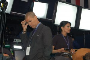 MARTIN L. CAHN | HERALD Vladimir Duthiers and Reena Ninan, anchors for CBS' live streaming news service, CBSN, prepare to join the network's web channel's coverage following the Vice Presidential Debate in Farmville.