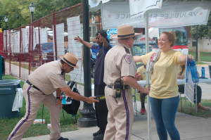 JORDAN MILES | HERALD Officers with a contracted security firm use metal detectors, checking members of the public for weapons and other objects at the entrance to Stubbs Mall.