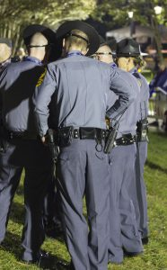 CARSON REEHER | HERALD Police officers congregate on Stubbs Mall during the viewing of the vice presidential debate.