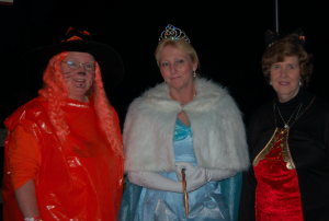 """MARTIN L. CAHN   HERALD Sallie Mowbray, Alexis McWilliams and Marie Hill get ready to greet """"victims"""" to the Historic Village at Lee Wayside's """"Boo-Thru"""" in Buckingham."""