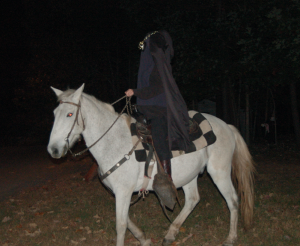 MARTIN L. CAHN   HERALD The Headless Horseman rode all the way from Sleepy Hollow to ask folks making their way along the Boo-Thru whether they knew where his head had gone. No one seemed to know.