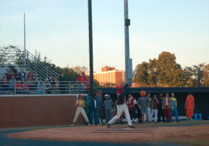 MARTIN L. CAHN | HERALD Deadpool (freshman infielder Antwaun Tucker) hits the ball as his teammates look on.