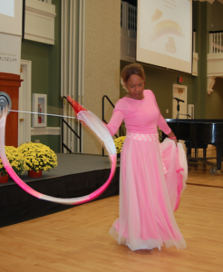 MARTIN L. CAHN | HERALD Lily Osborne Redd, a cancer survivor, performs a liturgical dance during Saturday's Rainbow Tea & Hat Sale.