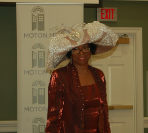 MARTIN L. CAHN | HERALD Moton Museum Family Challenge Chair Joy Cabarrus Speakes models a fancy hat during the event.