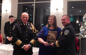 RHONDA FINCH | HERALD Farmville Volunteer Fire Department firefighter Julie Bailey accepts the Most Dedicated Award during the department's annual banquet at the Farmville Municipal Golf Course on Saturday evening. Presenting her with the award are Chief Andrew Goss, left, and First Assistant Chief Dean Farmer.