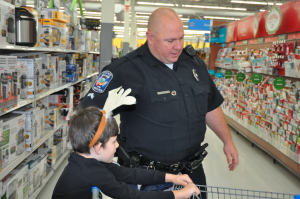 JORDAN MILES | HERALD Tauren Wynne chats with Cpl. Jason Talbott about what he wants to purchase for his family for Christmas.