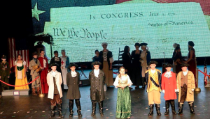 """Six middle school students portrayed America's Founding Fathers who stated the importance of Jesus Christ to our nation with their original words. Pictured are, from left, Chad Jones, Finn Jones, Cody Petersheim, Cally Vogel (Colonial """"Hostess""""), Addison Heslip, Matthew Davis and Davis Snoddy"""