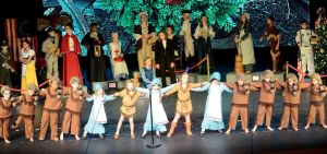 """First-graders depicted pioneers and Indians who stoppedtheir hard work on Christmas to celebrate Jesus' birth in peace. The Museum """"Exhibits"""" are seen in the background. Pictured along the front row, from left, are Carter Jackson, Bryce Whaley, Jacob Johnson, William Hogge, Maddelin Trejo, Anna Claire Bristol, Sierra Petersheim, Briana Wilson, Nina Davis, Sammy Ranson, Dakota Martin, Hunter Giffin and David Salinas."""
