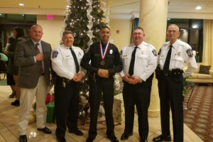 "FARMVILLE POLICE DEPARTMENT Officer Peter Carter, middle, stands with the leadership of the Farmville Police Department. Pictured are, from left, Detective Sgt. Chris Moss, Capt. Bill Hogan, Carter, Chief A.Q. ""Andy"" Ellington and Lt. John Garrett."