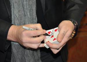 JORDAN MILES | HERALD Crews shuffles cards during a magic trick.
