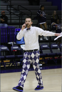 Longwood Assistant Director of Athletics Marketing Steve Robertson gets the crowd primed for the Diaper Derby during halftime of the men's basketball game Jan. 19 in Willett Hall.