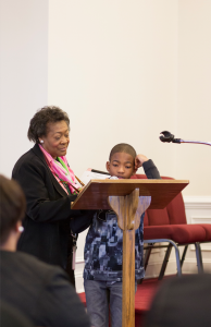 Mary Morton Smith, mistress of ceremonies, helps Kameron Williams, right, present reflections of Dr. Martin Luther King Jr.