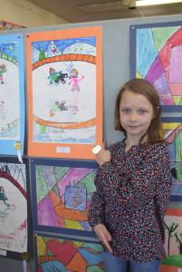 Third-grader Evelyn Johnson shows off her work.